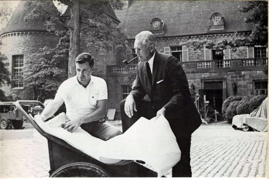 Viewing the early plans for the college