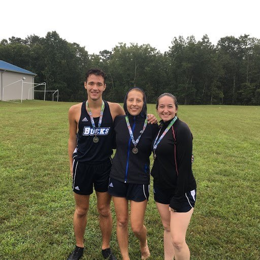 Reland Saugling (4th place; 24:03.60), Patty Higgins (13th place; 26:28.67) and Logan Saugling (7th place; 18:59.79).